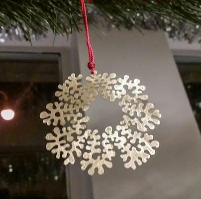 Hand pierced brass ornament